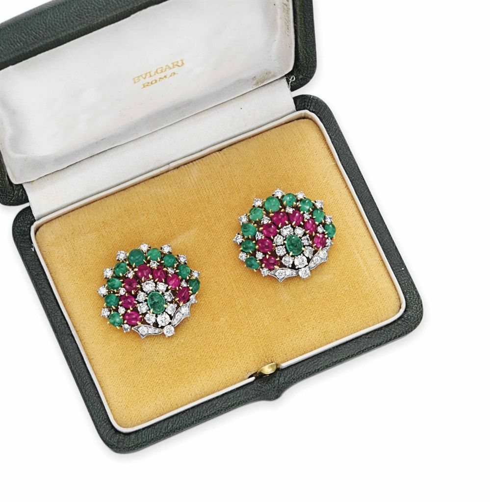 A pair of diamond ruby and emerald ear clips by bvlgari jewelry