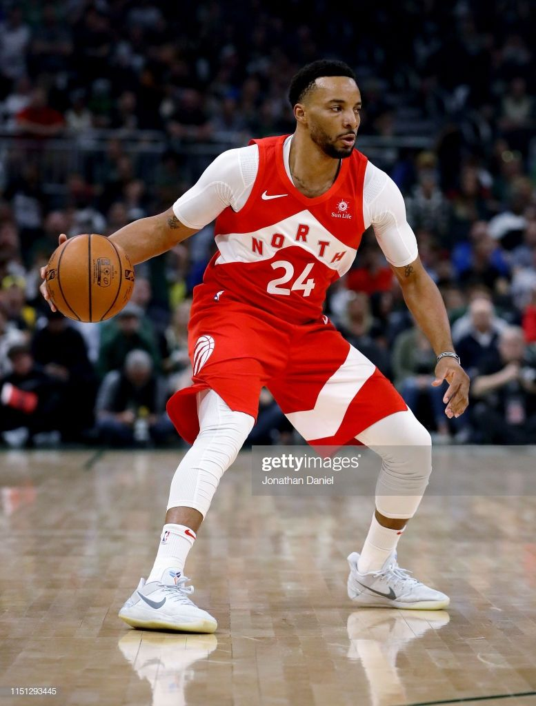 Norman Powell Of The Toronto Raptors Dribbles The Ball In