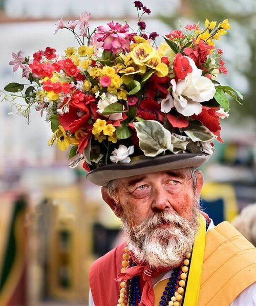 Hey, um, Mr. Man, your hat is uh, covered in flowers...lemme just...uh...help you....