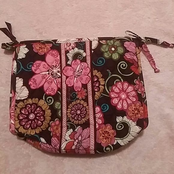 """NWOT Vera Bradley PinkFloral on Brown Cosmetic Bag New with no tags.  Zippered top with a tied bow on one end and a place to hold or hang up the makeup bag.  The cornes fold up into the bag - they are supposed to.  Inside on one side is a full length zippered compartment, the other side features 3 mesh pouches.  Measures 10.5""""w x 9""""h Vera Bradley Bags Cosmetic Bags & Cases"""