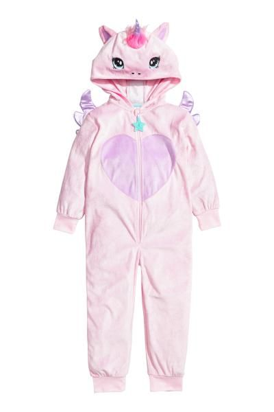 Velour unicorn costume with a hood, zip down the front an a detachable tail at the back. Appliqués on the hood and back and ribbing at the cuffs and hems.