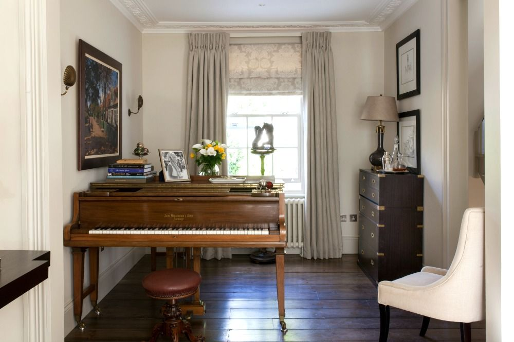 The grand piano and oak flooring in the drawing room of interior designer Justin Van Breda's home