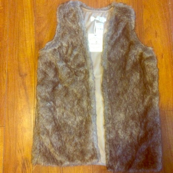 Urmoda Faux Fur Vest Urmoda Faux Fur Vest. Size Medium. New with tags still attached. Never worn. Urmoda Jackets & Coats Vests