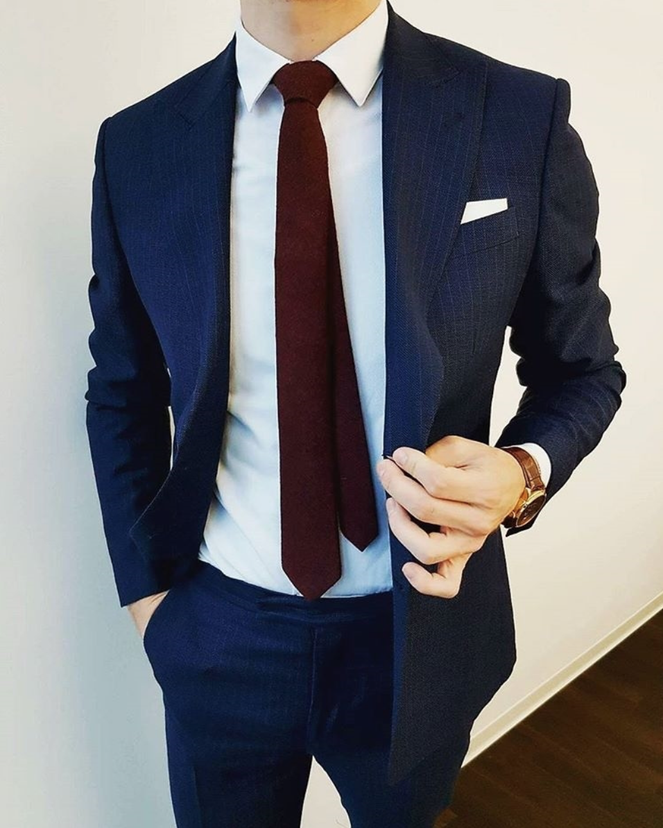 Blue suit, white shirt and burgundy tie with a white pocket square ...