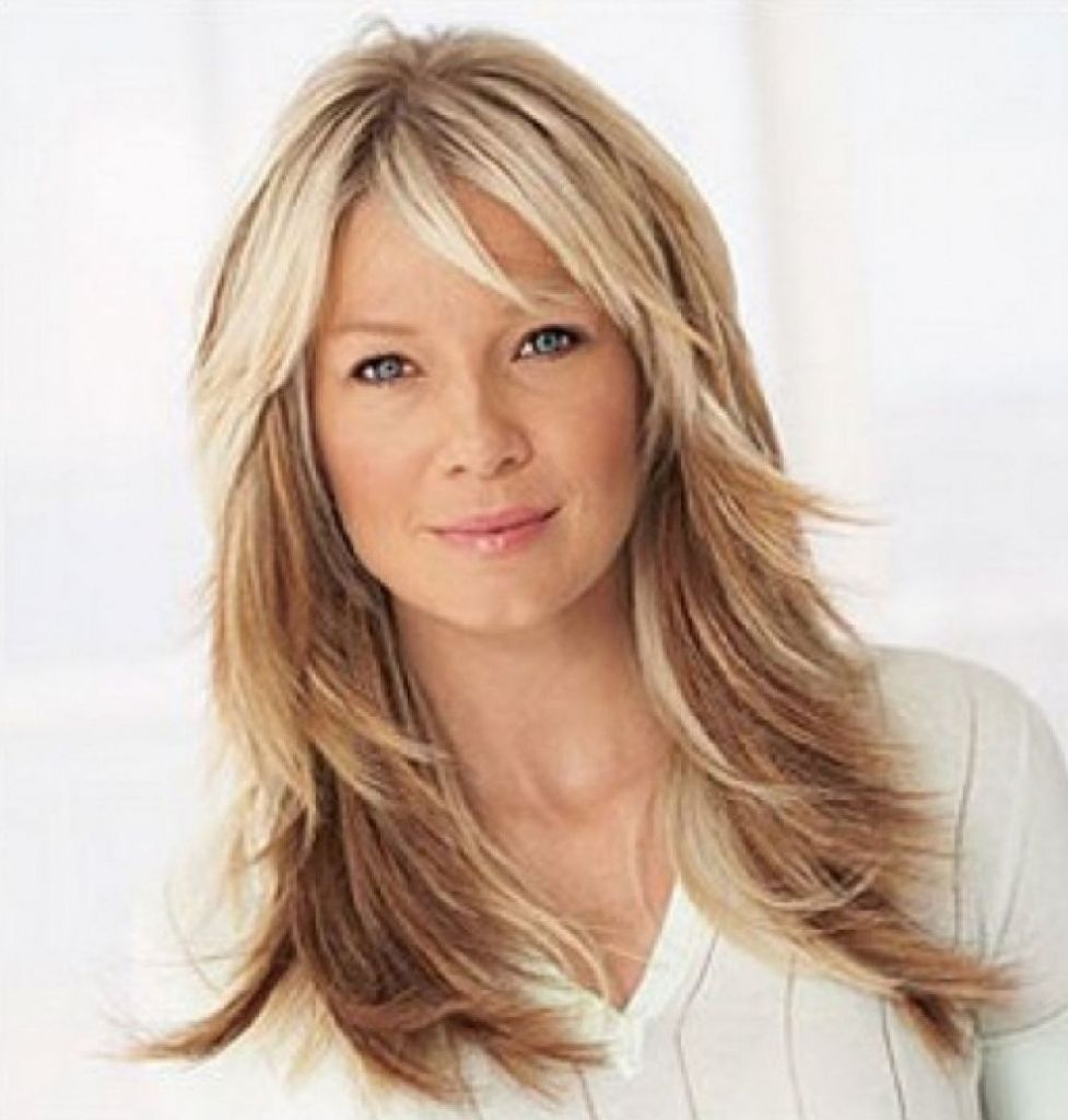 long layered haircuts for women over 40 wavy layered hairstyles with
