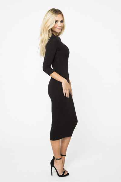 A funnel neck and sleek ribbed silhouette make this body conscious dress a definite knockout. Long Sleeves and quality knit pull on styling makes it incredibly easy to wear. 73% rayon, 27% nylon.