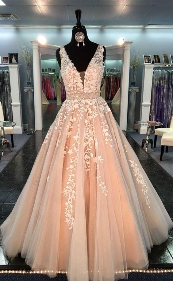 Pastel peach colored v-neck ball gown for the wedding or formal occasion