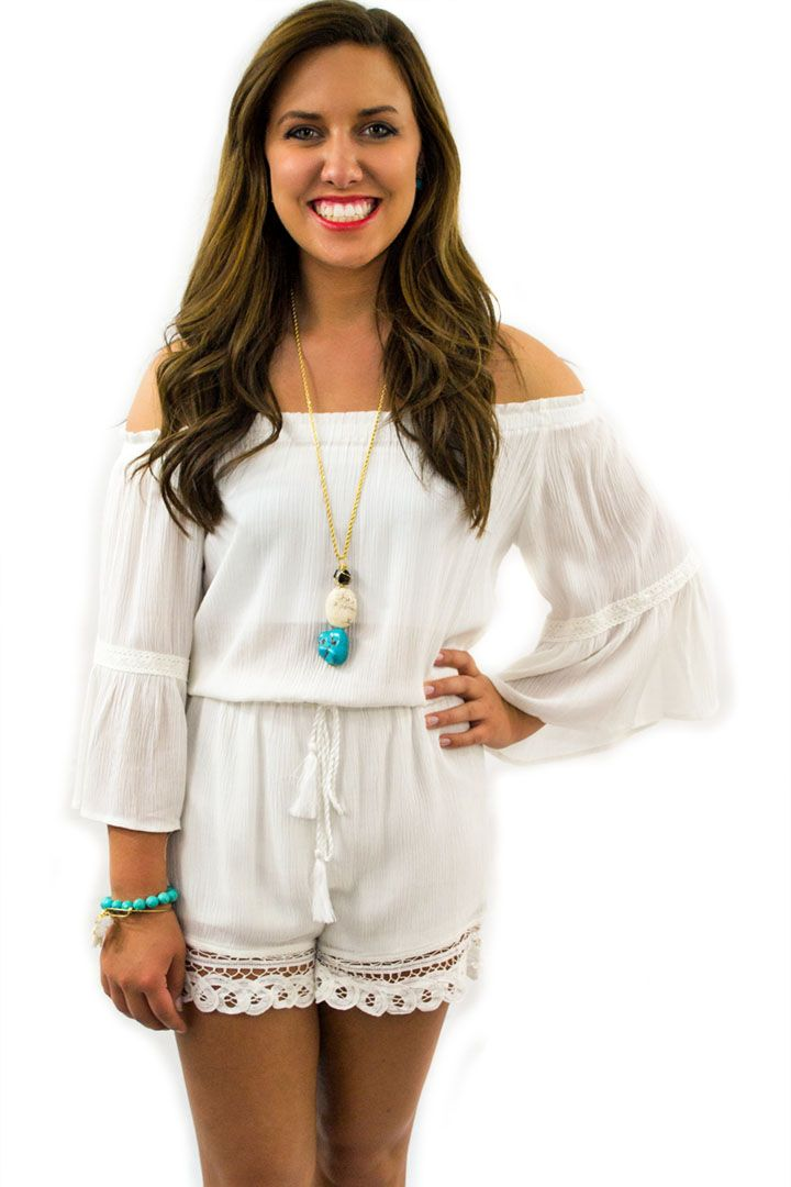 White Romper - $38.95 - A classy White Romper with lace trim on the legs and loose flowing sleeves and cuffs, a perfect spring fashion to add to your wardrobe.  | available at http://www.envyboutique.us/product/white-romper/ |  #Envy #Boutique #fashion #fashiontrends
