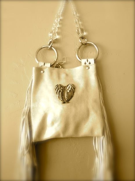 I call this bag the Cadillac Cowgirl. White leather hand made wings, fringe and a very cool clear handle.