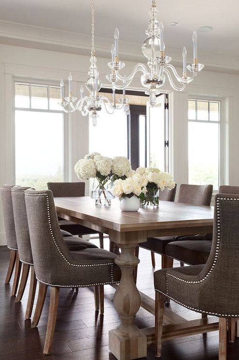 Dining room decor - Eclectic romantic masculine dining room with feminine touches in the flowers and chandeliers | nousDECOR.com