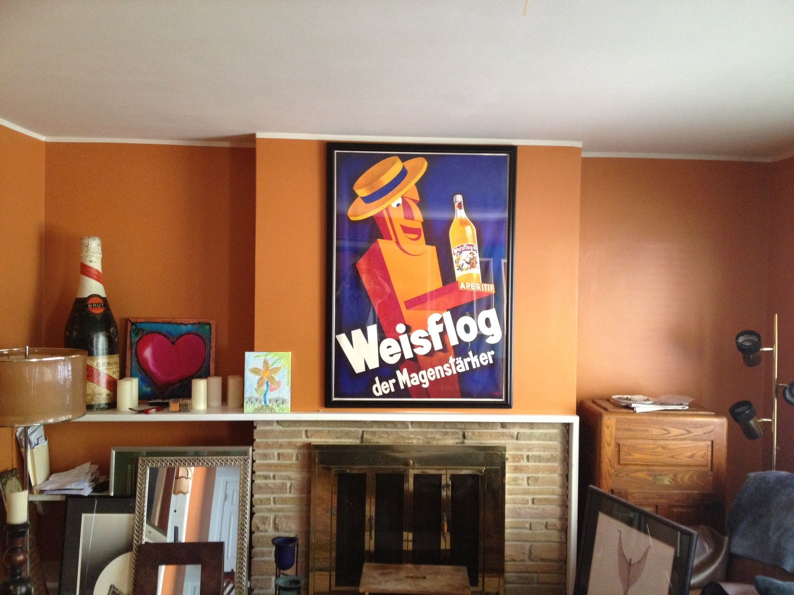 weisflog original vintage poster above fire place blue wine originalvintage fireplace