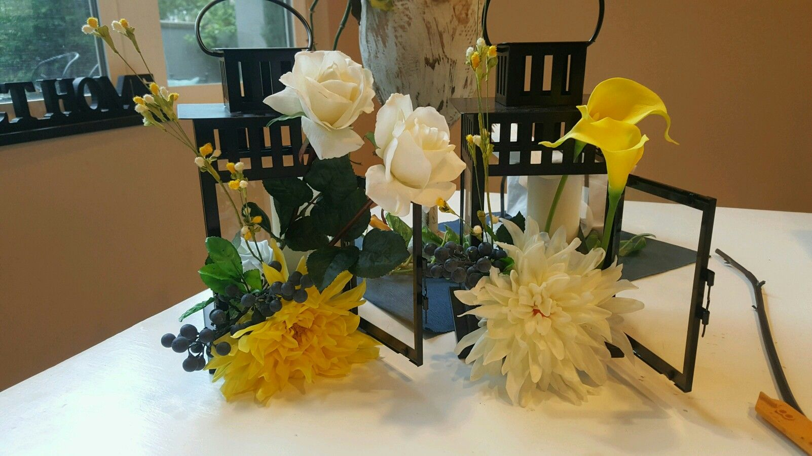 Wedding centerpieces yellow navy blueberries and white in