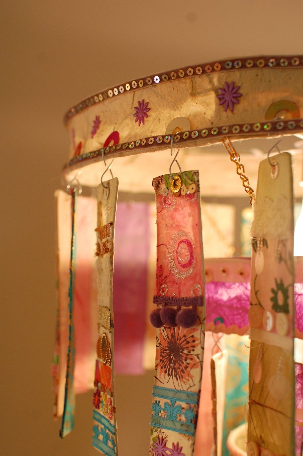 Inspiration three tier chandelier radiance art auction a detail of a handmade three tier chandelier made from strips of handmade paper and embellishes with buttins beads and arubaitofo Gallery