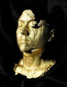 portrait sculpture in gold plate stainless steel by Sophie Kahn