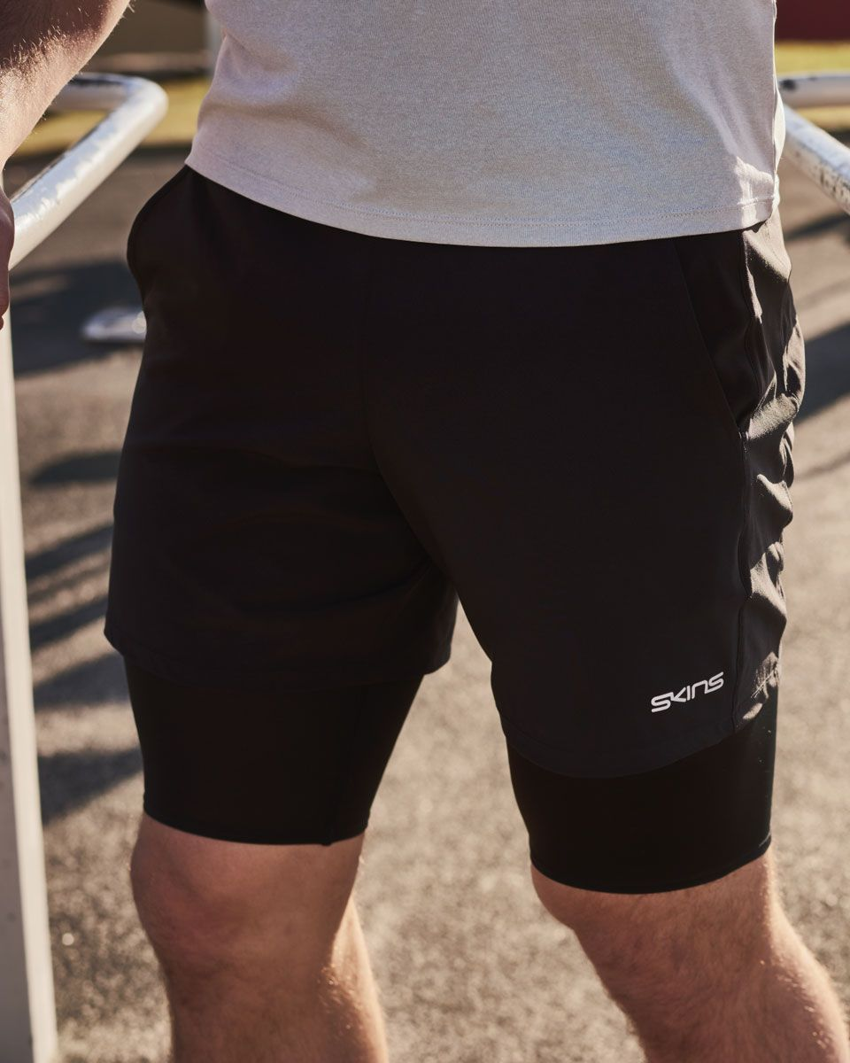 285e99df238d7 SKINS DNAmic PRIMARY Superpose Half Tights: our ultimate hybrid performance  shorts for coverage and comfort