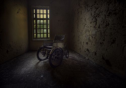 one of the only times i have found something like this , part motobike and part wheel chair . Not sure about the top speed but  a strange contraption indeed to find in an abandoned sanatorium .