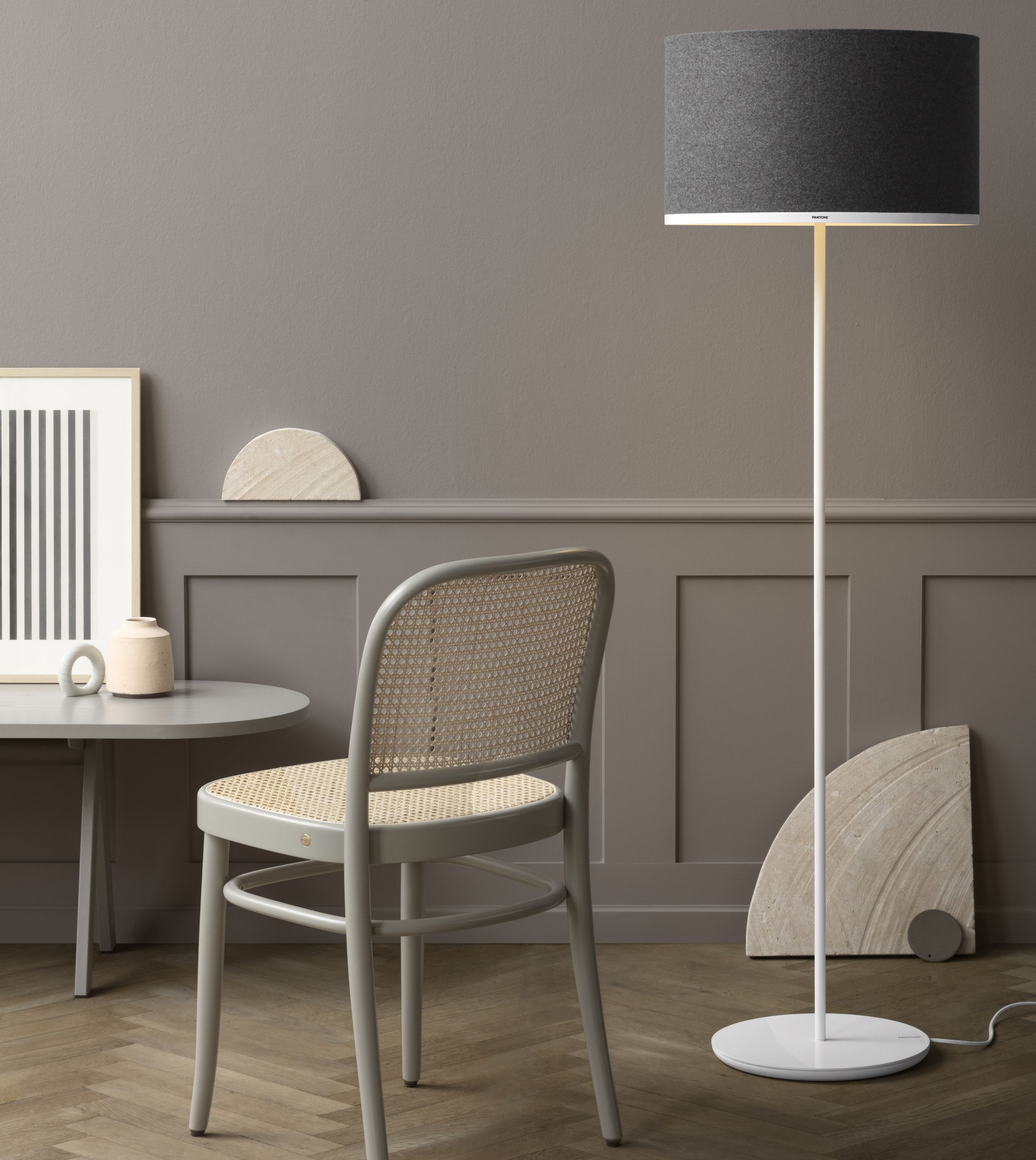 The Antares floor lamp with Sargas shade adds a sophisticated look