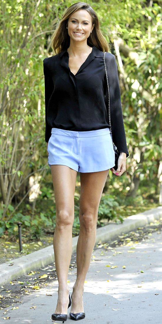 On her way to a breakfast meeting, Stacy Keibler stepped out in a black blouse, periwinkle blue short shorts and black accessories.