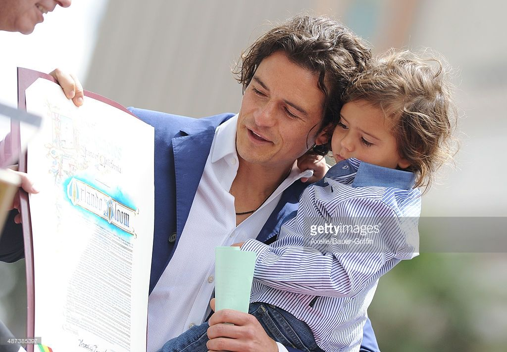 Actor Orlando Bloom and his son Flynn Bloom attend the ceremony honoring Orlando Bloom with a Star on The Hollywood Walk of Fame on April 2, 2014 in Hollywood, California.