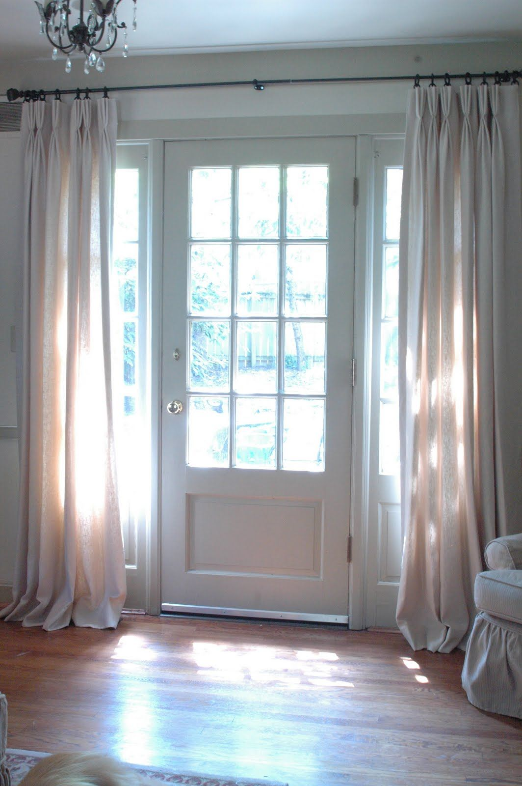 More hanging curtains by the front door only if curtains for Front door with window on top