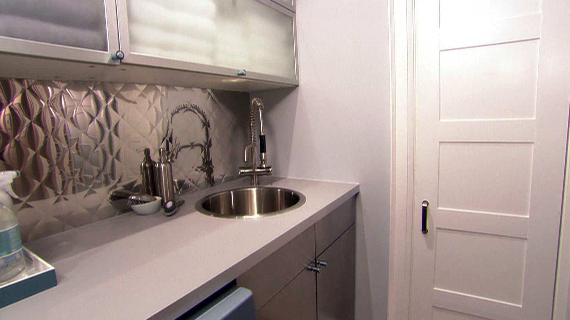 Sarah's sleek, industrial laundry room could make doing laundry enjoyable.