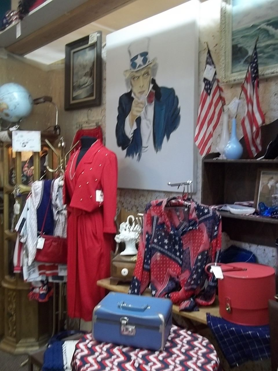 4th of July Display Riverside  California , Mission Galleria -Flags from the 1920's era Cases from the 40-60's era. Seascapes hand painted -From Sea to Shinning Sea. Uncle Sam hand painted