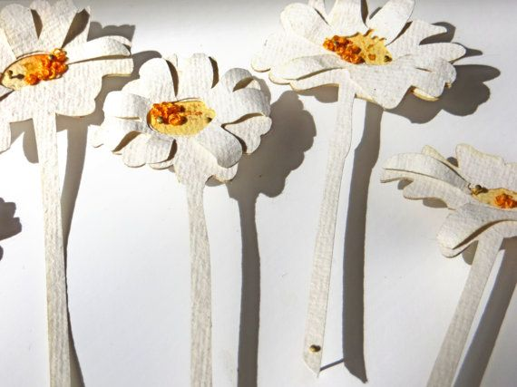 Paper cut Daisies by Bryoney Fawn. Layered paper cut pieces with watercolour and stitch. Pinned away from a backing to cast beautiful shadows.