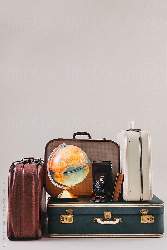 Vintage suitcases with a globe, old camera and antique book. by BONNINSTUDIO for Stocksy United
