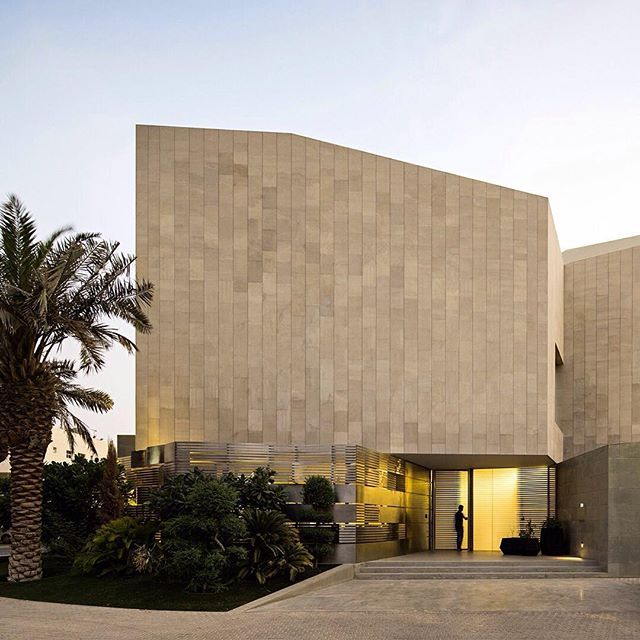 Four roof terraces are concealed behind the multi-tonal stone facade of this house in Kuwait – the Arab state with an impressive legacy of Modern architecture. Find out more and see the full image set on dezeen.com/tag/kuwait #architecture #house #terrace #stone #Kuwait