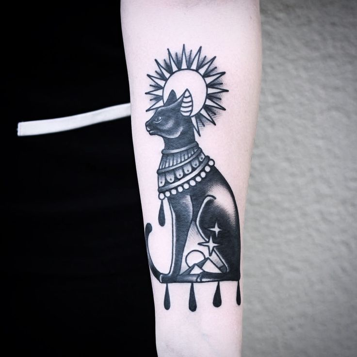 Black Ink Bastet Egyptian Tattoo On Left Arm Egyptian Tattoo Cat Tattoo Designs Egyptian Cat Tattoos