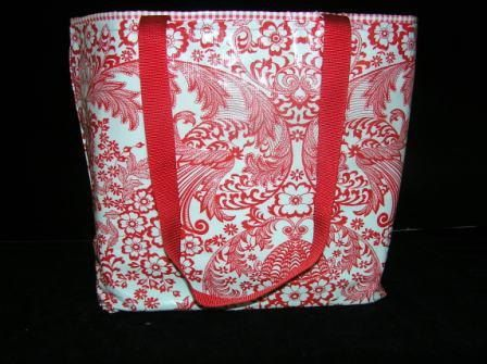The Perfect Small Tote Bag by IrresistiblesLLC on Etsy made of oilcloth to keep the bag dry and fresh looking!  Love the bright red color.