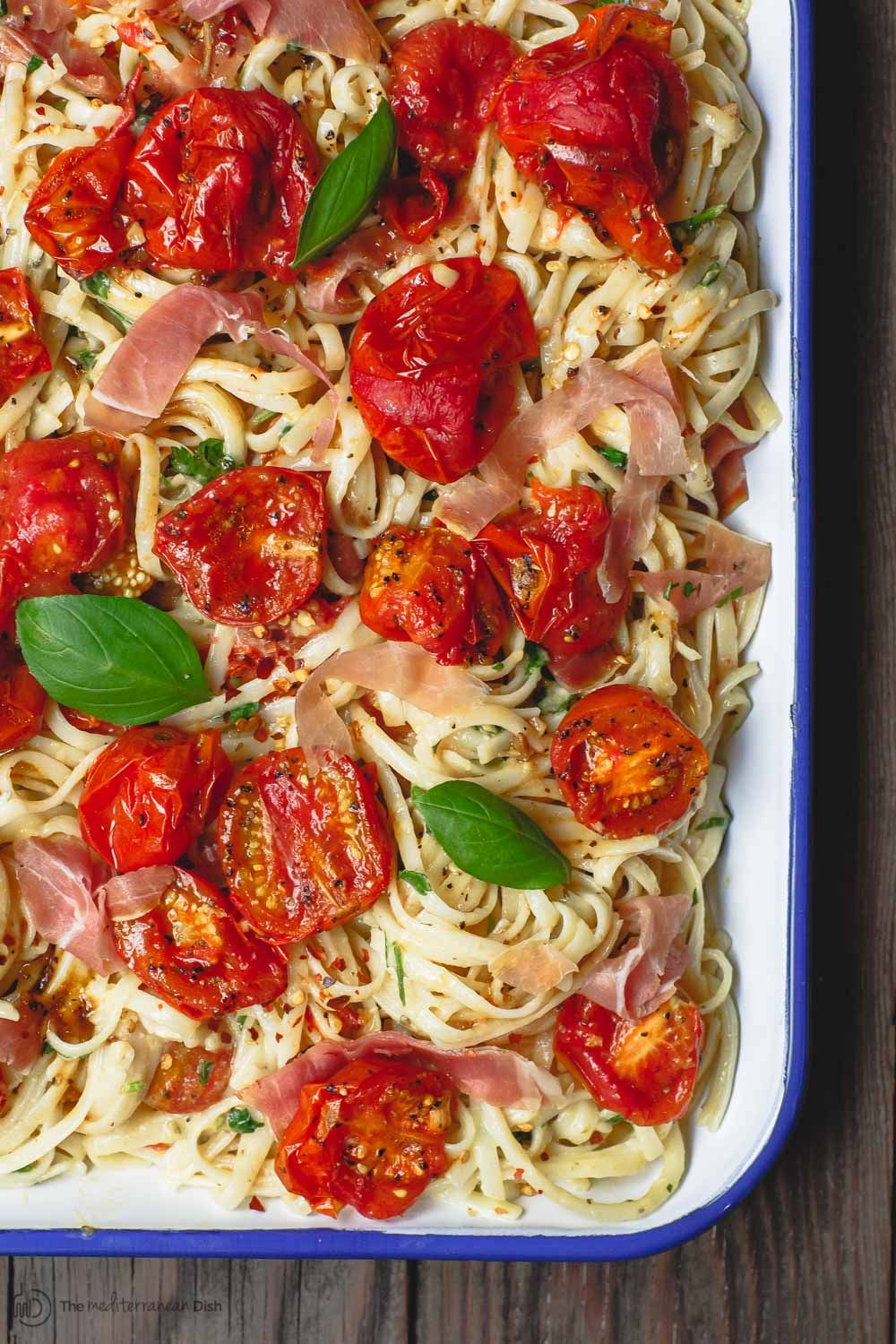 A Lighter Flavor Packed Easy Carbonara Recipe With Garlic Roasted Tomatoes And Fresh Herbs Plus Easy Carbonara Recipe Carbonara Recipe Mediterranean Recipes