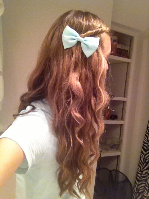 this is my hair curled with a mint green bow on the side!