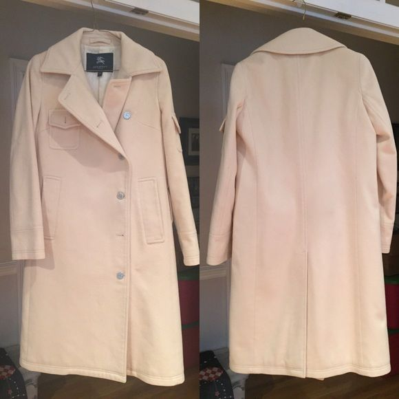 Women's Wool Burberry Long Dress Coat Size Medium. In fair condition. It is missing two buttons. No stains on the outside, a few stains on the inside lining as pictures but doesn't affect the coat in any way. The price reflects both the buttons missing and the stains. This is a 100% wool heavy, nice women's dress coat. These retail over 1500$. Offers welcome. 100% authentic. Burberry Jackets & Coats Pea Coats