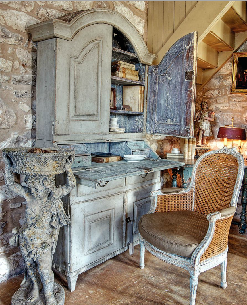 I think I would lighten up on the distressing of the cabinetry, loving the angel planter & chair.