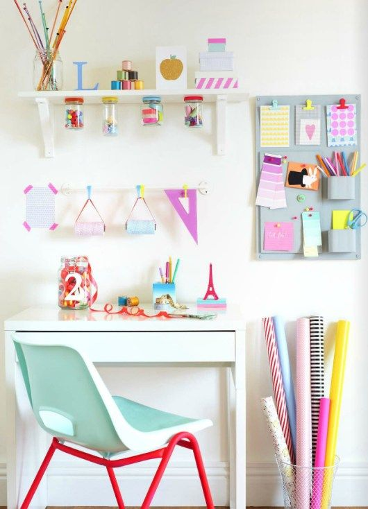 White workspace with gift wrapping station.