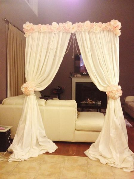 Altar arch made with backdrop stand cheap fabric and flowers