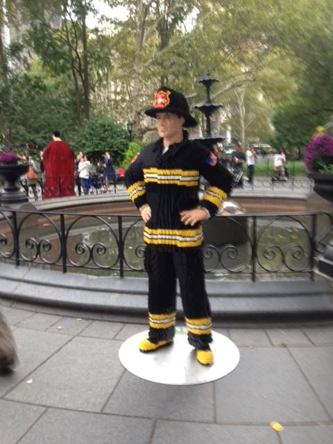 In honor of the grand opening of the new LEGO store located in the Flatiron District of Manhattan, LEGO master builders Have created a number of life-size sculptures which are on display in Madison Square Park, including this really cool firefighter! Photo by Allyson Ryan
