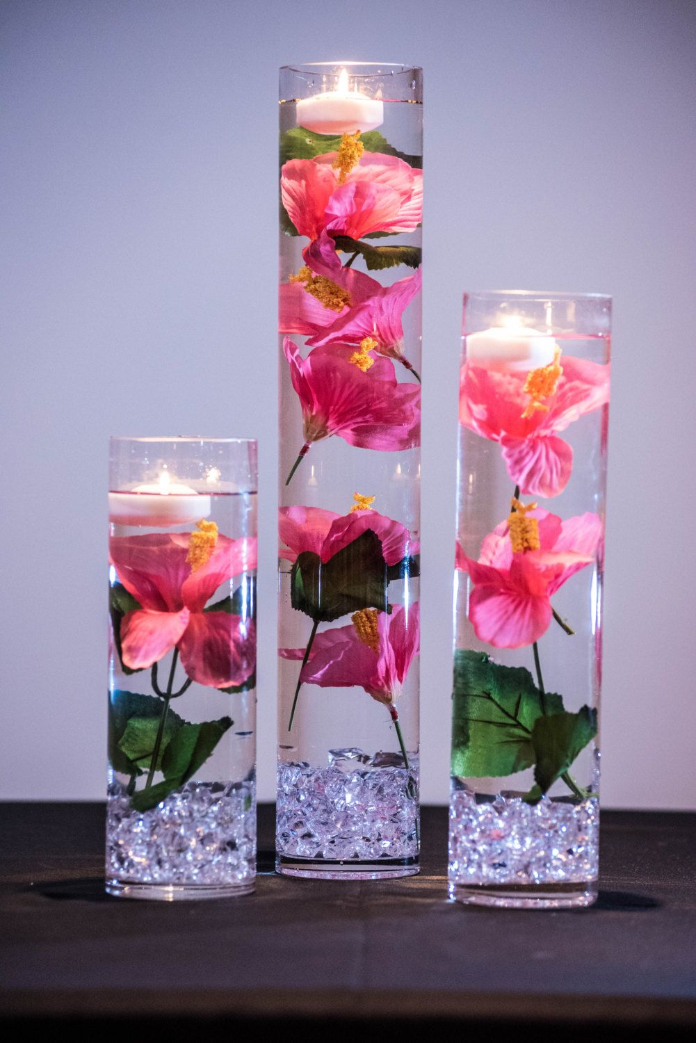 This table setting will include the following 1 20 x 4 cylinder submersible pink hibiscus floral wedding centerpiece with floating candles and acrylic crystals kit mightylinksfo