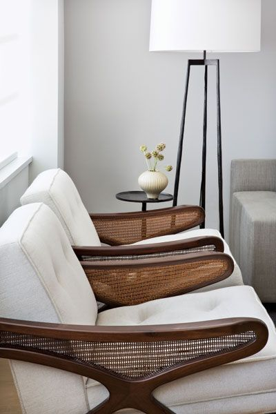 #TODesign - In the living area Italian 1950s armchairs are punctuated by Christian Liaigres end table and floor lamp. via Ingrid Coffeng - http://ift.tt/1J8kf61