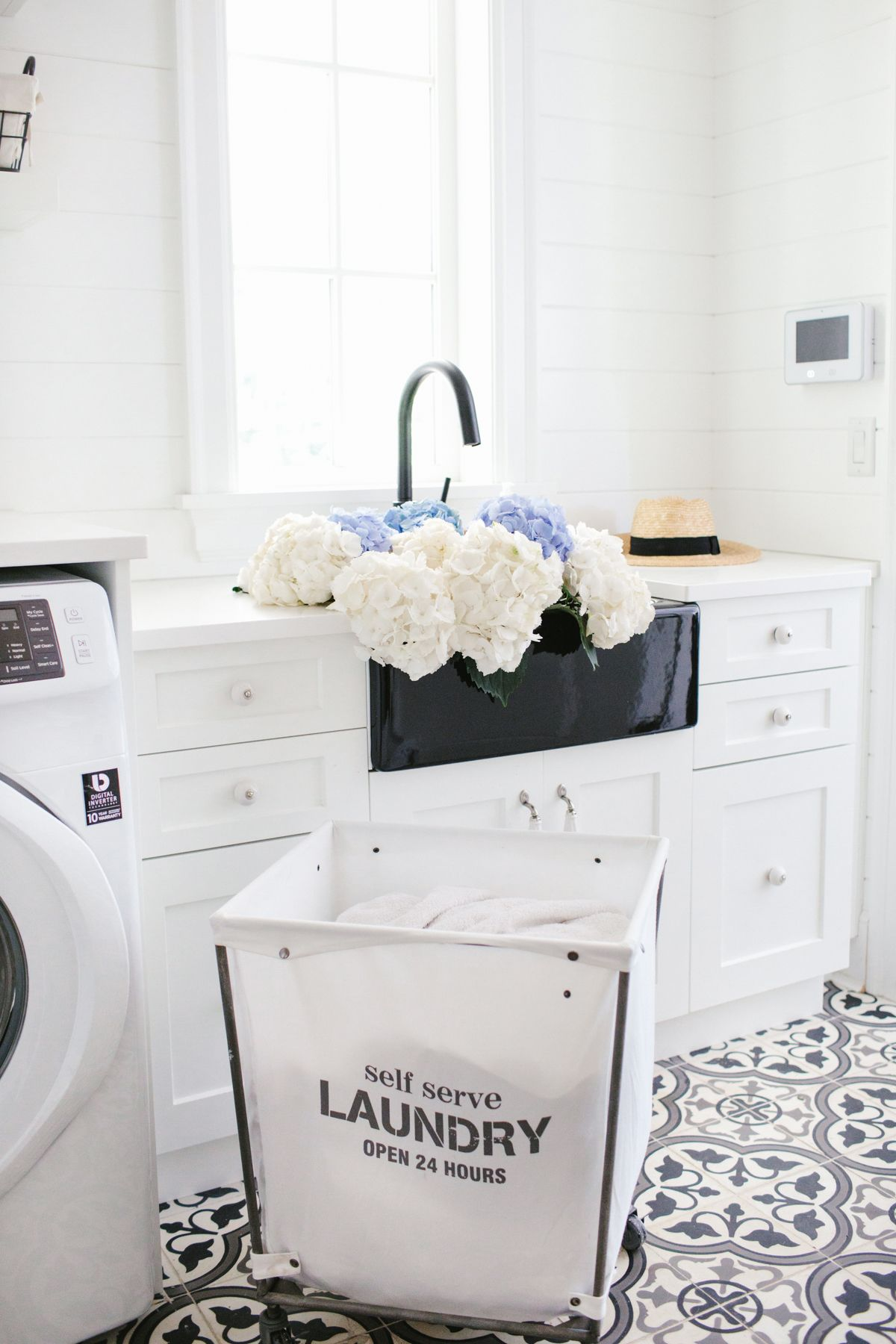 White Laundry Room with Black Farm Sink Black and White Tile Floor