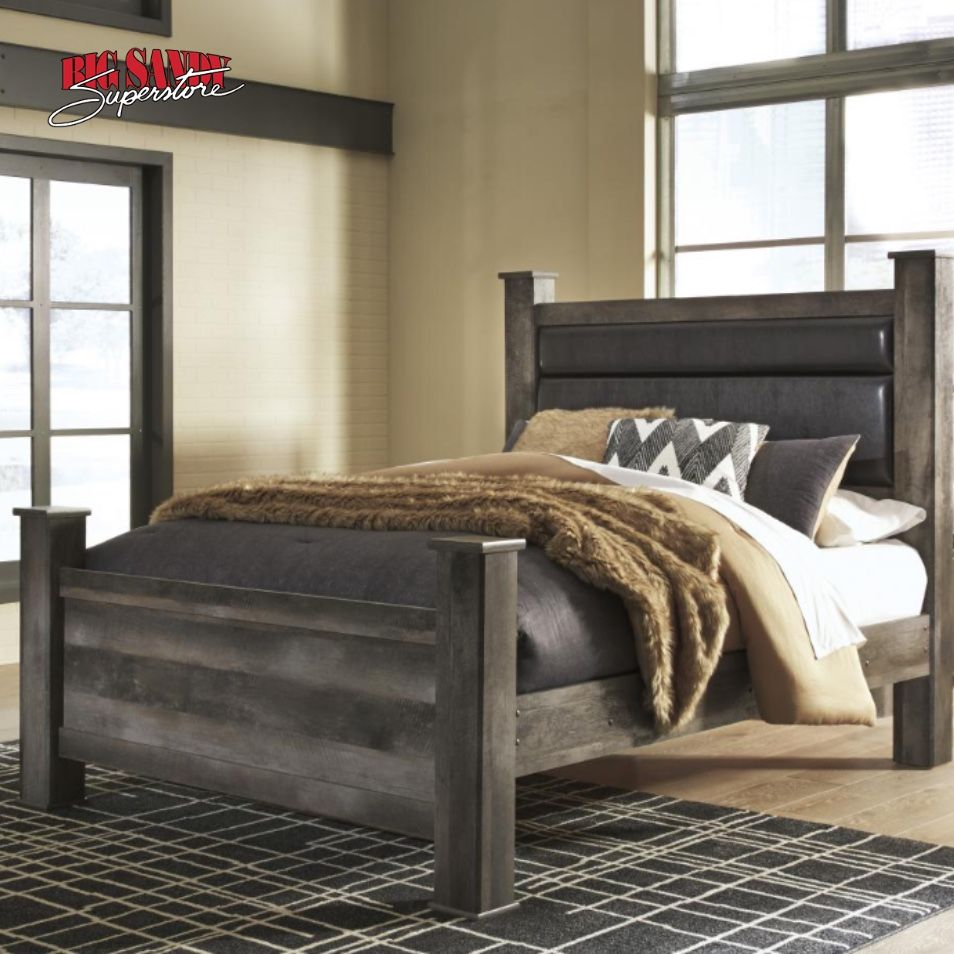 The Wynnlow queen upholstered poster bed is sure to win