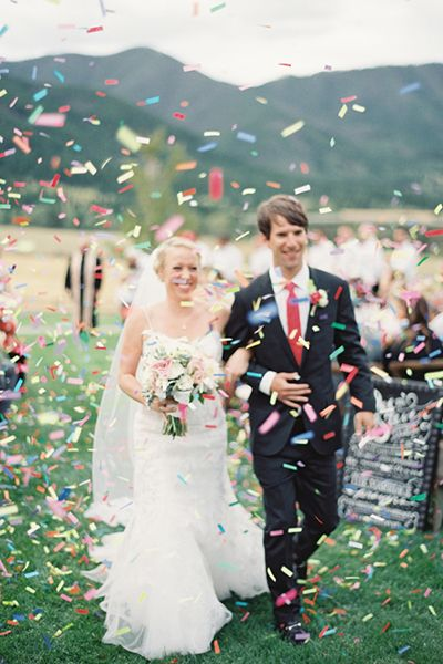 Hand out confetti for guests to toss during your exit. It's way more fun than rice and will look prettier in photos, too.