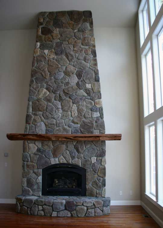 fireplace and chimney. very tall stone and brick fireplace  19 chimney it sure