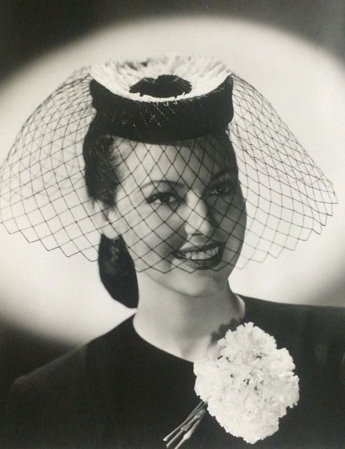 Ava Gardner wearing a hat by Walter Florell