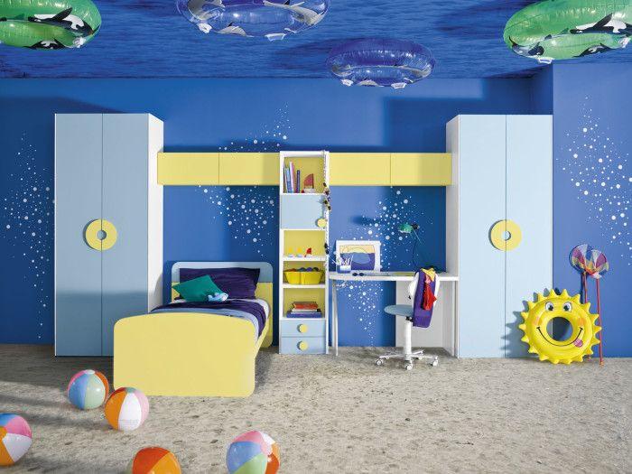 bedroom beach themed bedroom for kids blue shelves white desk swimming ring donut beach ball