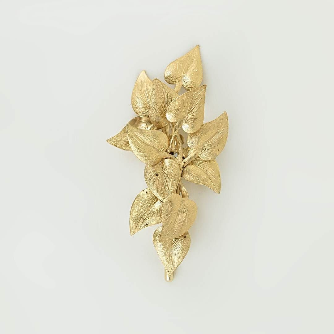 Brass #VARÓN Boutonniere with floral Deltoid accents .. Style is the perfection of a point of view.