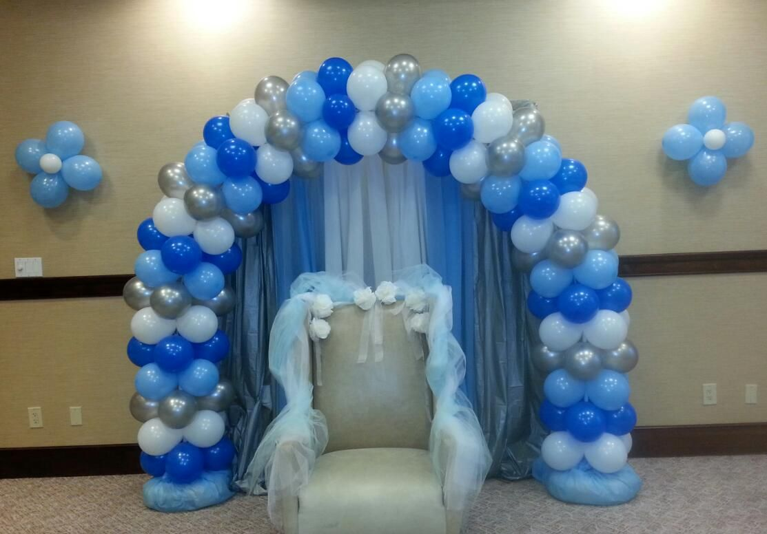 Light Blue Blue Silver And White Balloon Arch And Wall Flowers