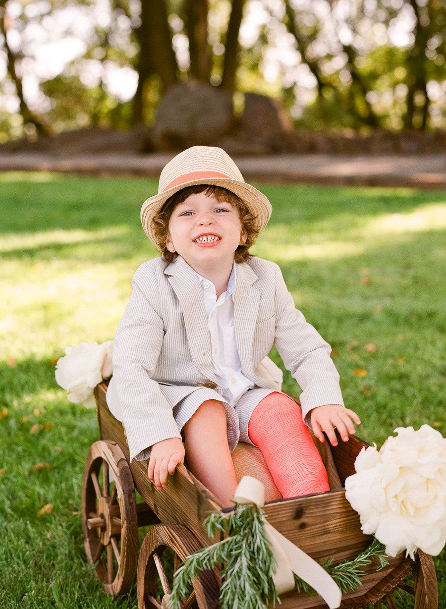 This ring bearer has a broken leg, but this is a great way to include a non-mobile kid in your wedding day.
