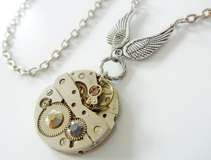 Vintage watch movement with wings and swarovski crystals. A Timeless Relic by FunkyGlam Jewellery
